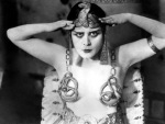 1917: Promotional portrait of American actor Theda Bara (1885 - 1955) wearing an Egyptian headdress and breast plates with a snake design for director J Gordon Edwards' film, 'Cleopatra'.