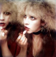 LOS ANGELES - 1985:  Singer Stevie Nicks puts on lipstick backstage in 1985 in Los Angeles, California. (Photo by Donaldson Collection/Michael Ochs Archives/Getty Images)